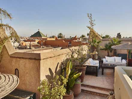 Riad rooftop with views over Marrakech Medina.